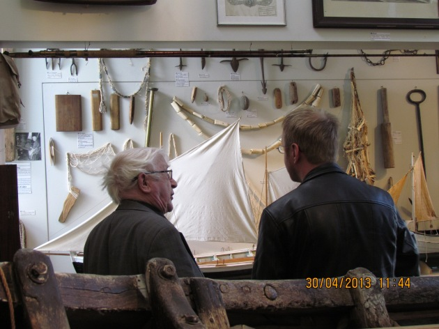 Thordur Tomasson explaining the exhibit to Ross